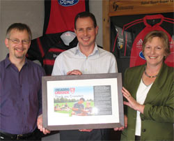 Bill Nagelkerke, Children's and Young Adult Services Coordinator, and Pat Street, Programmes and Learning Manager presented Hamish with a framed 'thank you'