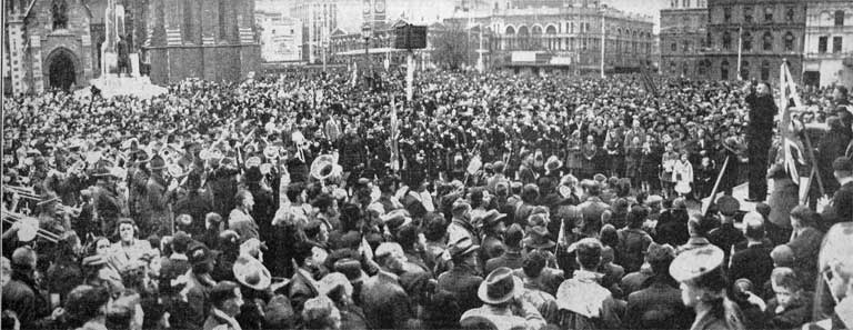Caption: Victory celebration stirs Christchurch crowds. Christchurch turned out yesterday en masse to attend the second day of Victory Celebrations. A section of the crowd in the Square. Description: 10 May 1945 Source: The Press, 11 May 1945, p.8