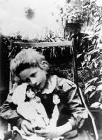 Ngaio Marsh as a child with two of her dolls