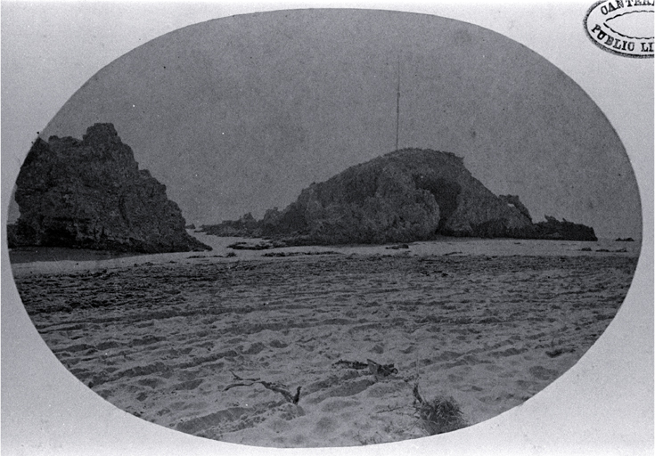Cave Rock with the mast and yard-arm used to signal the state of the Sumner Bar tides