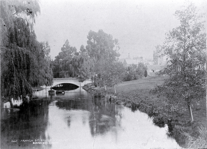 A horse with cart is watered at Armagh Street Bridge, Christchurch : Provincial Buildings and Supreme Court at left