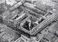Aerial view of the gutted shell of the three-storied department building