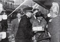 A Salvation Army worker provides tea for firemen and volunteers battling the fire