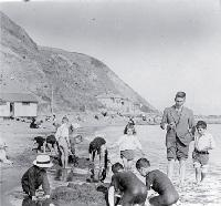 Children building sandcastles on the beach, possibly Wellington [ca. 1905]