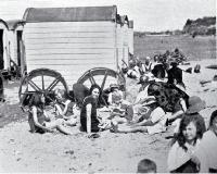 Bathing machines and sun bathers at Caroline Bay, Timaru [1927]