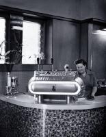 Woman serving expresso coffee at Fails Cafe, 82 Cashel Street, near the Bridge of Remembrance [ca. 1955]
