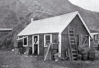 The first Ferry accommodation house, little more than a two-roomed clay whare built by Arthur Munsen who was also the ferryman [186-]