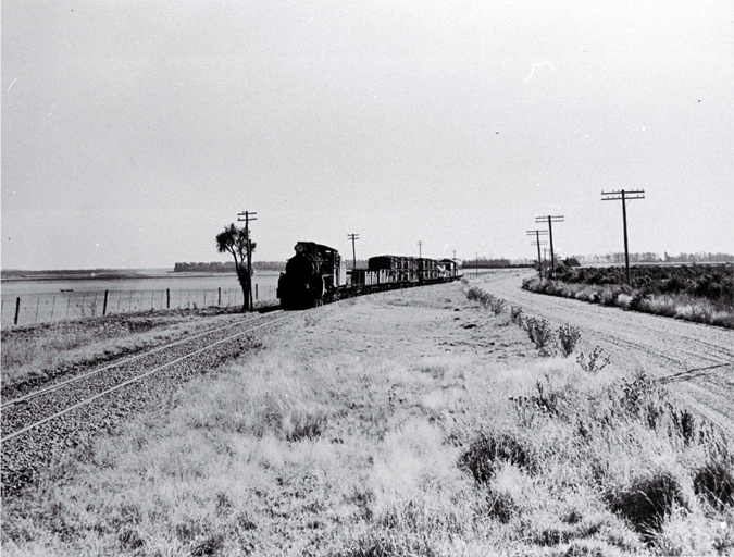An Ab class Pacific locomotive on the Rakaia-Methven branch line arriving at Rakaia, Mid Canterbury