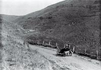 """ She stuck half-way up "" : a De Dion motor car on the Summit Road of the Port Hills, Christchurch."