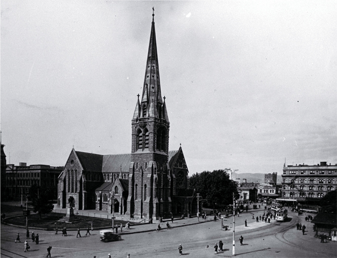 Pedestrians & trams in Cathedral Square, looking toward the Bank of New Zealand corner & the United Service Hotel, Christchurch