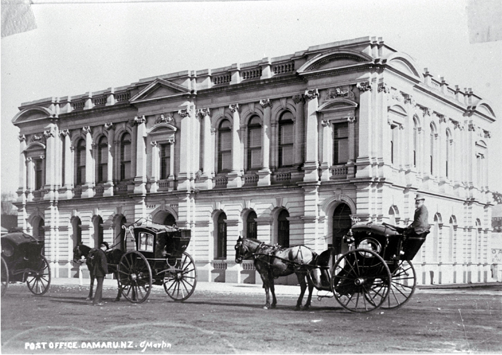 Hansom cabs stand outside the Post Office, Oamaru