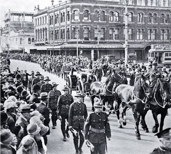 The gun carriage and firing party follow the wreath bearers, Christchurch