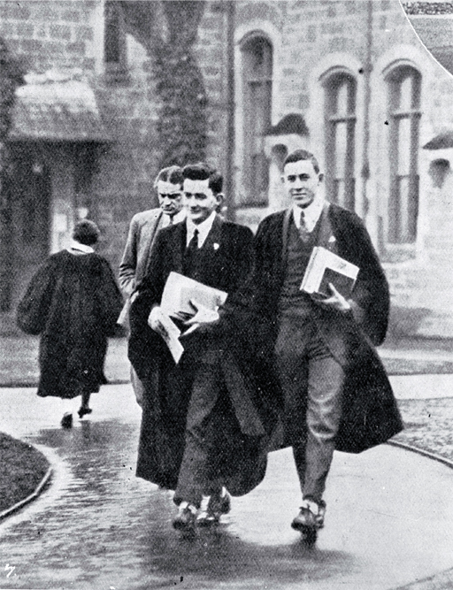 Undergraduate students in gowns in the quadrangle on their way to lecture rooms, Canterbury College