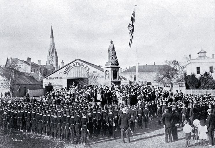 Public school cadets on Empire Day drawn up in front of the Victoria statue to salute the flag in Victoria Square, Christchurch