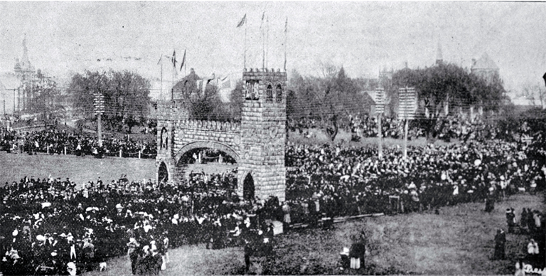A procession turns through the Triumphal Arch to Market Square at Queen Victoria's Jubilee celebrations