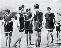 A group of young bathers in bathing costumes in the surf at Sumner beach on the Anniversary Day of Christchurch