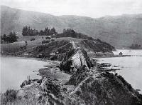 A historic spot in Akaroa Harbour at the neck of the Onawe Peninsula : remains of the Takapuneke Pa can still be seen. [1922]