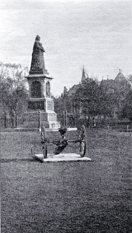 A pom pom gun captured from the Boers in front of the statue of Queen Victoria