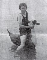 The Goose Girl : a young bather tests out her new inflatable at a local Christchurch beach. [1929]