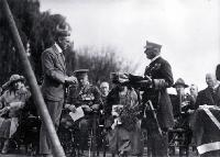 Mr Gummer, architect, presenting Lord Jellicoe with trowel and mallet, foundation stone ceremony, Bridge of Remembrance