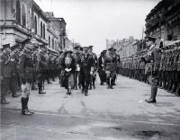 Lord and Lady Jellicoe passing the Guard of Honour, foundation stone ceremony, Bridge of Remembrance
