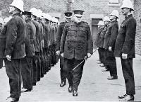 Superintendent W H Mackinnon makes his last inspection of his men, as the Christchurch police force bid him farewell [1926]