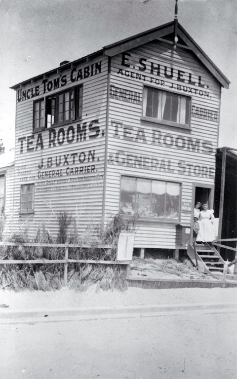 Uncle Tom's Cabin & Tearooms, North New Brighton, Christchurch : pictured on the step are two of the five proprietor/postmaster's family who ran the store.