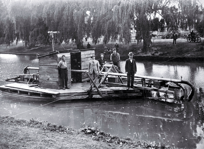 Richard Bedward Owen, pictured second from left on R.T. Stewart's river sweeper