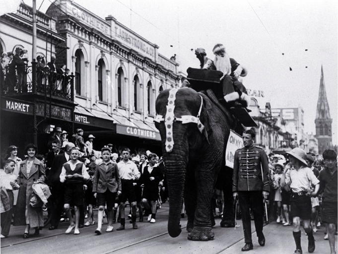 A Christmas parade passes along Colombo Street, Christchurch