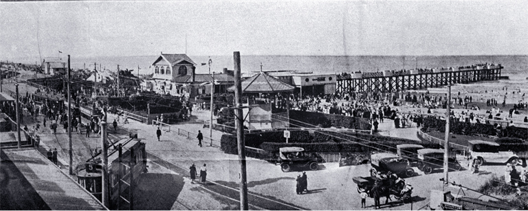 General view of pier and enclosures : showing terminus of two trams and pier front.