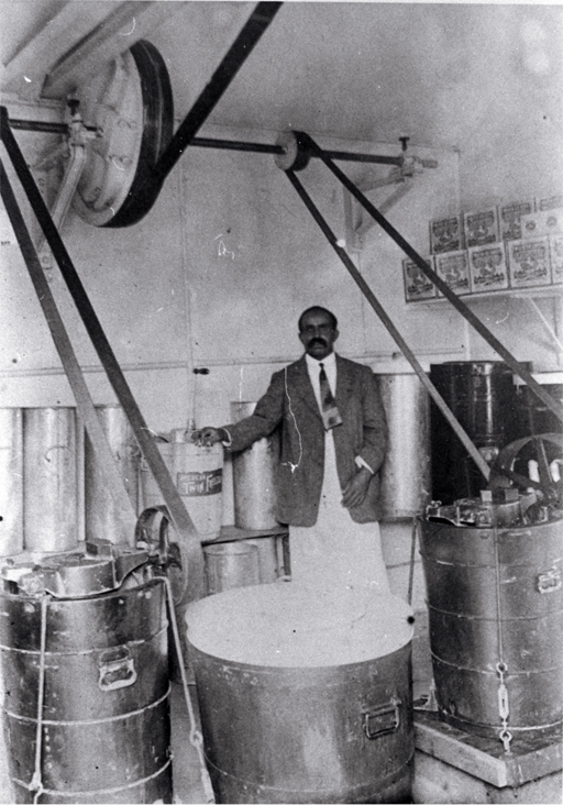 Sali Mahomet making icecream in his 'dairy' behind his house at 69 Caledonia Road, St Albans