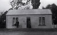 Amelia Frances Rogers (1849-1928) pictured with a postman, Mr Heffenden, outside 348 New Brighton Road which was also the Burwood Post Office until 1928