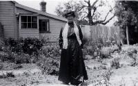 Amelia Frances Rogers (1849-1928) beside her riverside home at 348 New Brighton Road