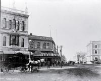A hackney at the intersection of Cashel & High Streets with Milner & Thompson's music store on the right & Inglis' building on the left