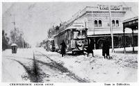 A tram runs into difficulties, at the corner of Colombo and Armagh Streets, when Christchurch was hit by snow [1918?]