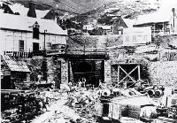 The Lyttelton portal of the Lyttelton Rail Tunnel with construction workers - click for enlargement