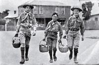 Cheerful boy scouts acting as messengers to distribute food and medicine to patients at their houses during the influenza epidemic
