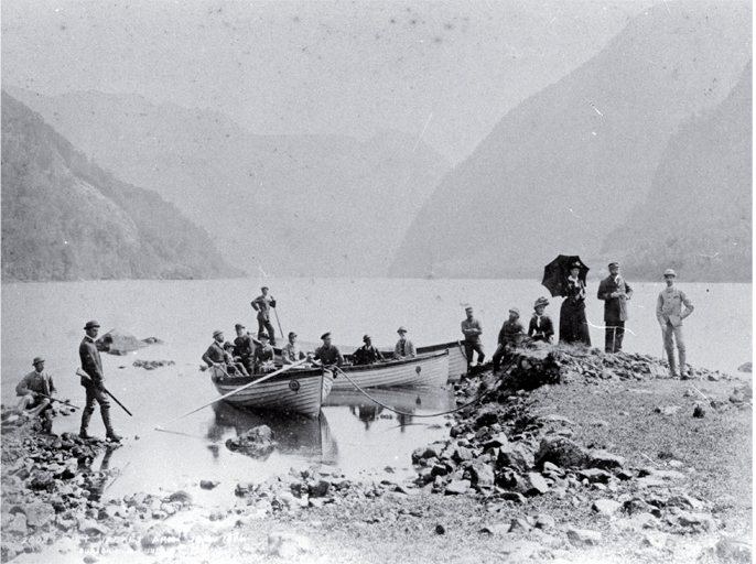 Tourists in small boats hunting in Wet Jacket Arm, Dusky Sound, Fiordland