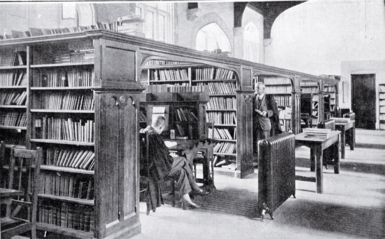 In the Canterbury College Library : the Acting Librarian, Mr Hardie, is seen facing the camera.