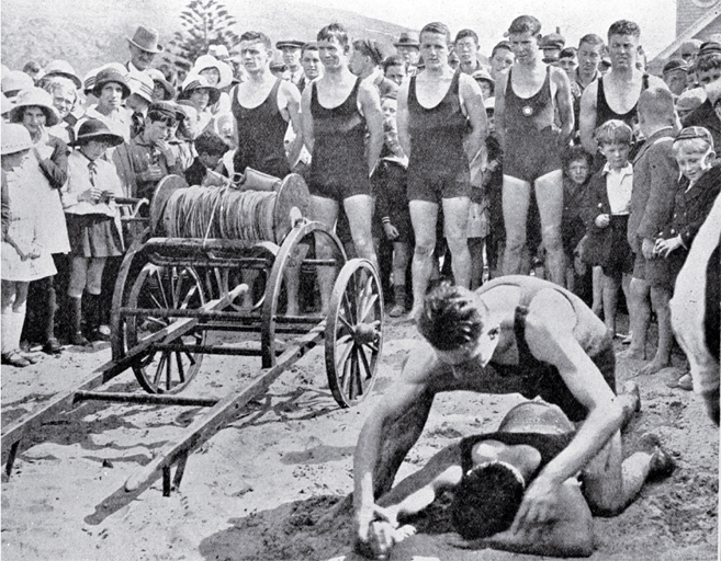 A demonstration of artificial respiration at the opening of the lifesaving season : team lined up behind the reel.