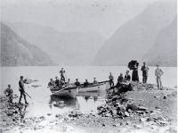 Tourists in small boats hunting in Wet Jacket Arm, Dusky Sound, Fiordland, ca Jan 1884