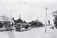 An electric tram at the intersection of Harewood Road and Main North Road, Christchurch, 1906