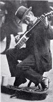 Busker with a banjo entertaining in Cathedral Square, Christchurch, ca 1927