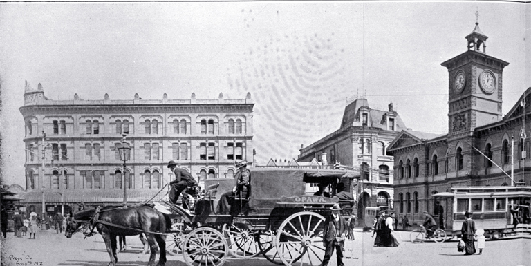 The Opawa coach waiting to depart in Cathedral Square : in background is Mortens Building (United Service Hotel)