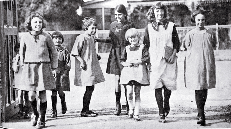 Are we downhearted? : girls merrily on their way to Phillipstown School on the day Christchurch schools reopened after five months due to the removal of restrictions on the assembly of children after the end of the infantile paralysis epidemic.