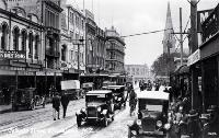 Cars, cyclists and pedestrians in Colombo Street, Christchurch, ca 1930