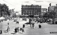 Pedestrians and a tram in Cathedral Square Christchurch, ca 1940