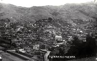 Railway lines at Lyttelton and panoramic views of houses and hills, ca 1910