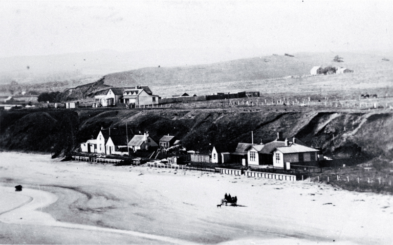 Waitangi showing Odman's and Heslop's hotels at the left : to the right is the combined post office and courthouse.