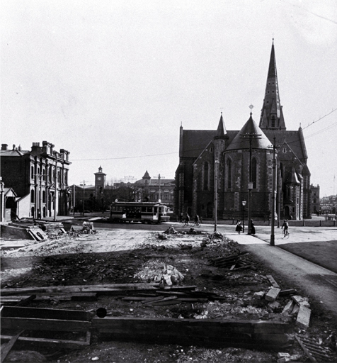 Rear of the Cathedral taken from the cleared site of the Tramway offices (now Government Buildings), Christchurch : at left is the Dalgety building.